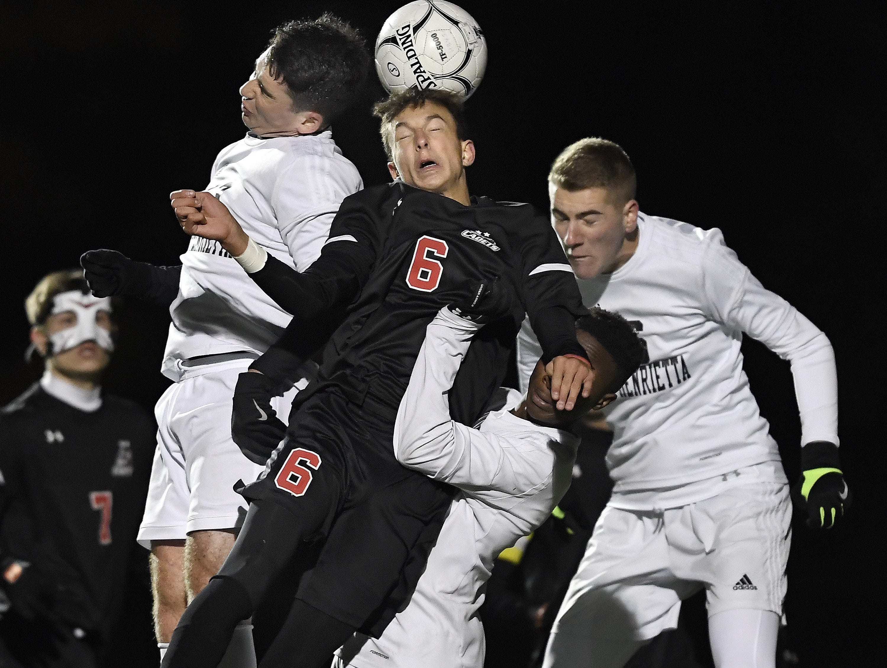 Hilton's Justin Arilotta connects on a header while surrounded by Rush-Henrietta defenders during the Section V Class AA championship game.