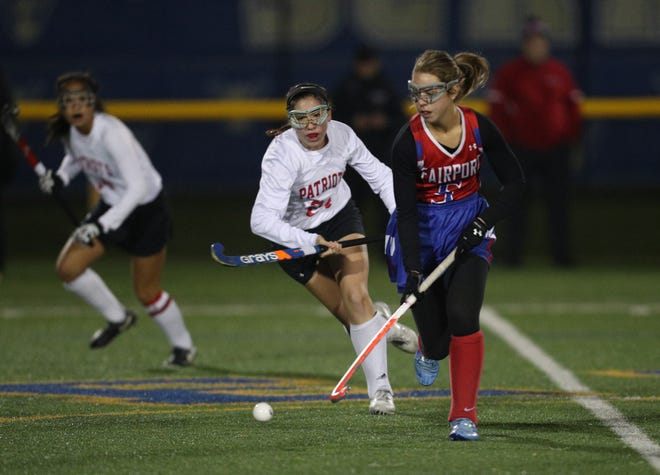 Fairport's Allison Belmont carries the ball through the middle of the field.