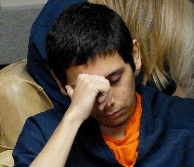 Samuel Scholfield, 18, is shown Tuesday at his arraignment in Shasta County Superior Court on murder, arson and other charges.