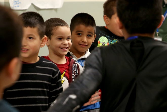 """Kids cheer on the Parade of Champions at Four Corners Elementary School in Salem on Wednesday, Oct. 31, 2018. Students were honored as """"champions"""" for missing one or fewer days of school in October, having no negative behavior marks or displaying this month's theme, courage, in school. A parade will be held with a different theme each month honoring students who meet those standards."""