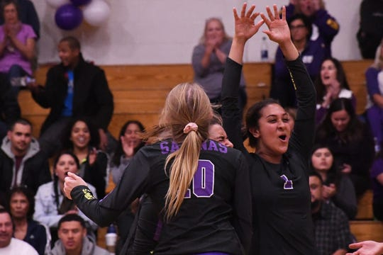 Outside hitters Ashleigh Souza (10) and Christina Chagnon and right side hitter Aloha Delk (1) celebrate a point during the third set of the 3-2 victory over Los Gatos.