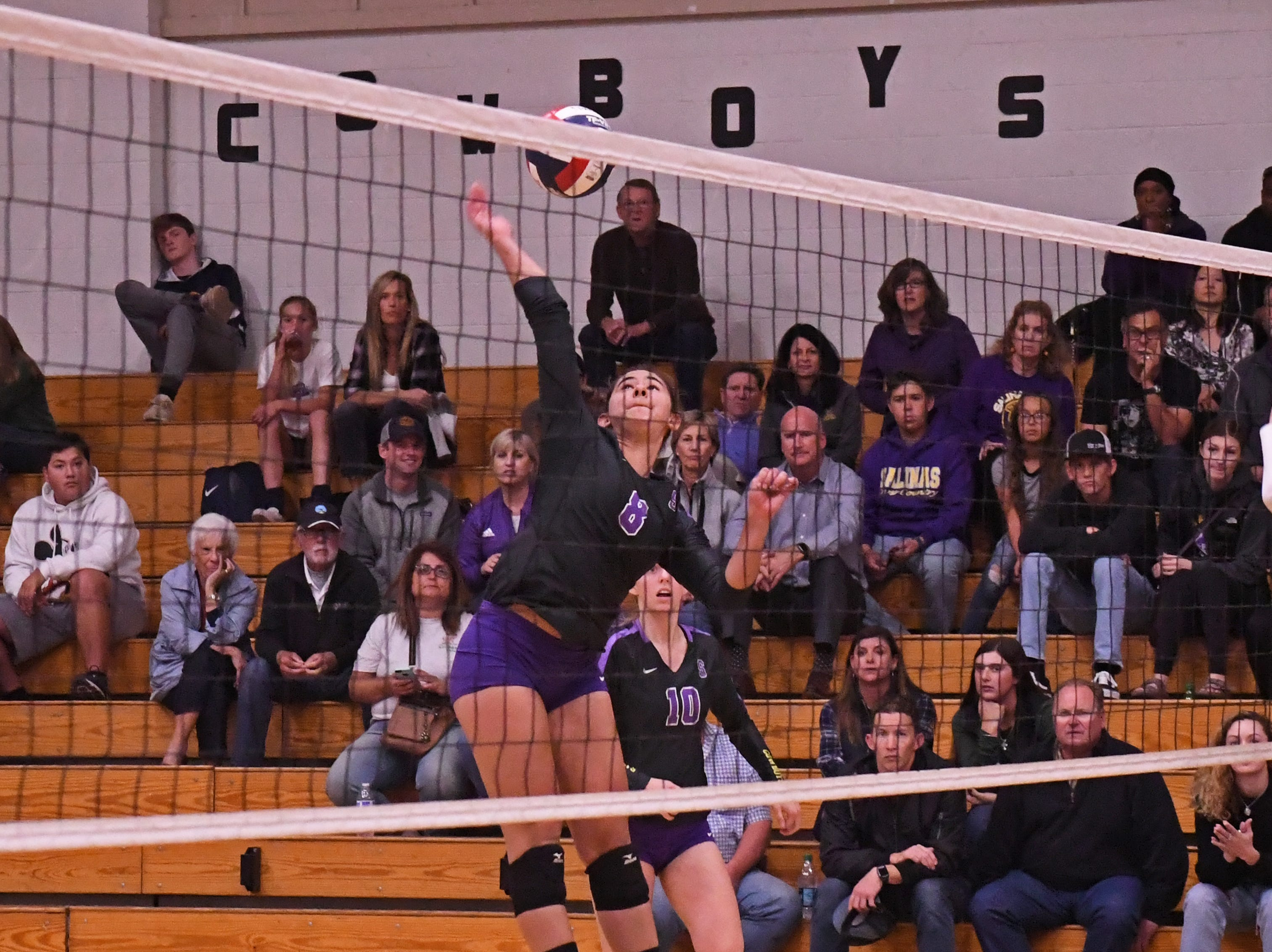 Middle blocker Christina Chagnon (8) fires a spike in the second set.