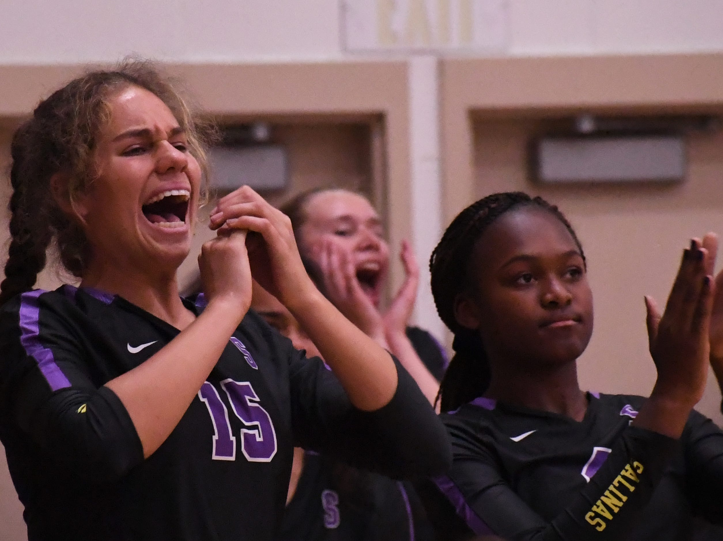 The Salinas sideline reacts to a point in the fourth set.