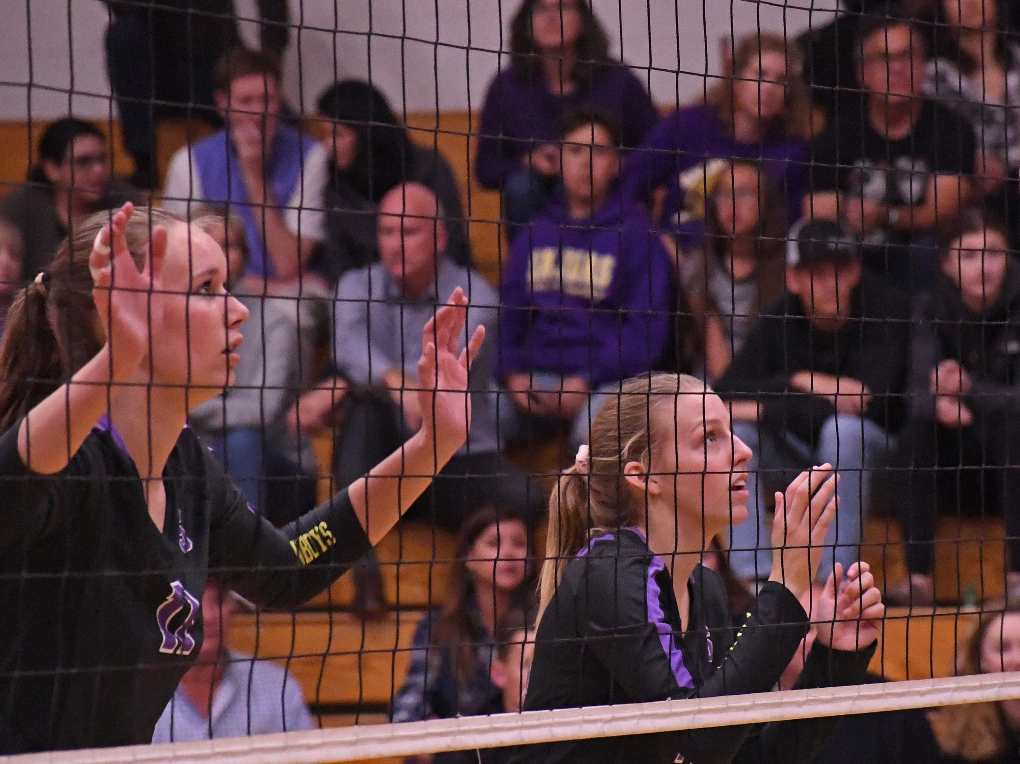 Middle blocker Savannah Maker (11) and outside hitter Ashleigh Souza (10) wait for a serve from Los Gatos' side.
