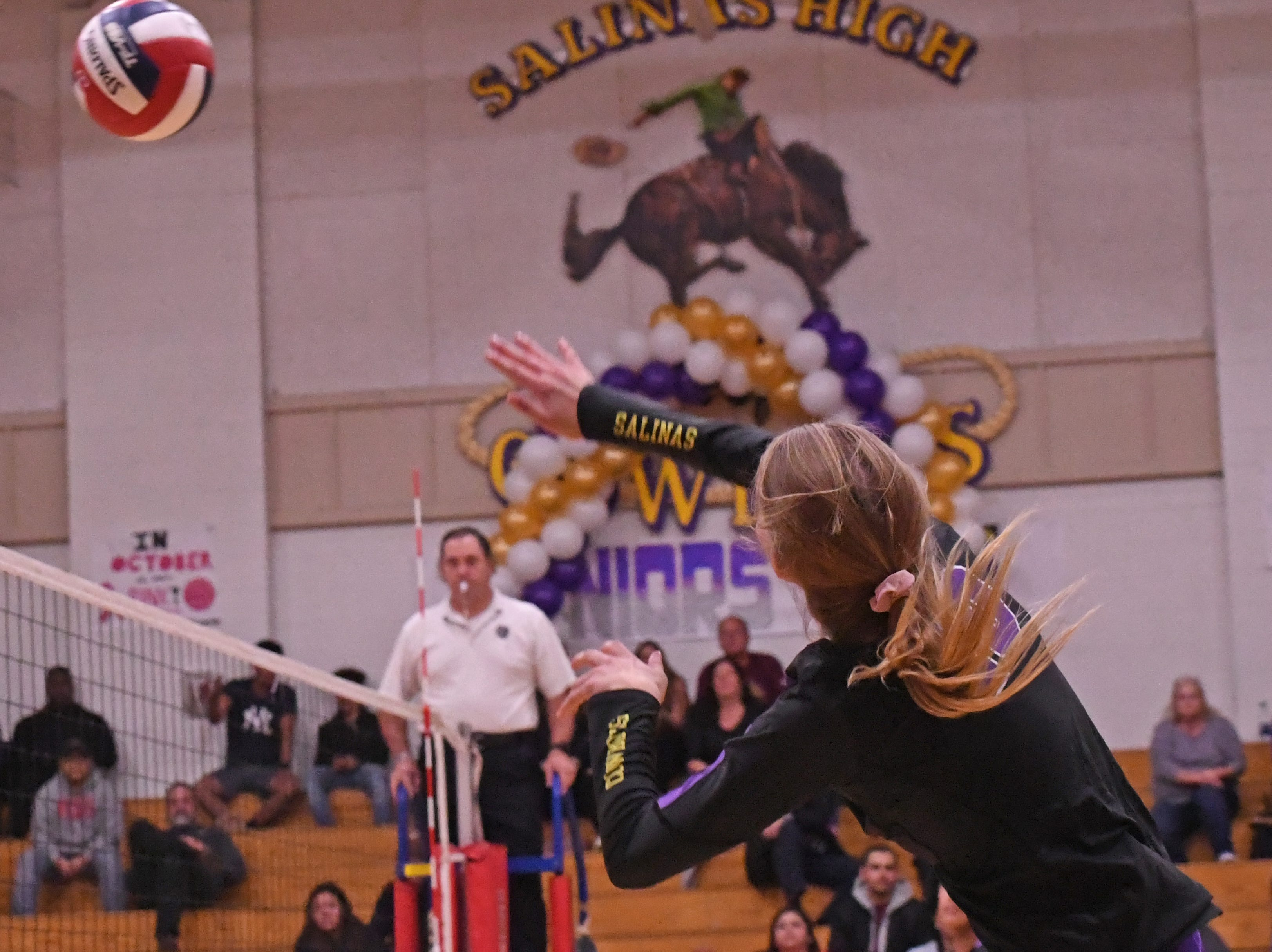 Outside hitter Ashleigh Souza (10) hits the ball over the net in the first set.