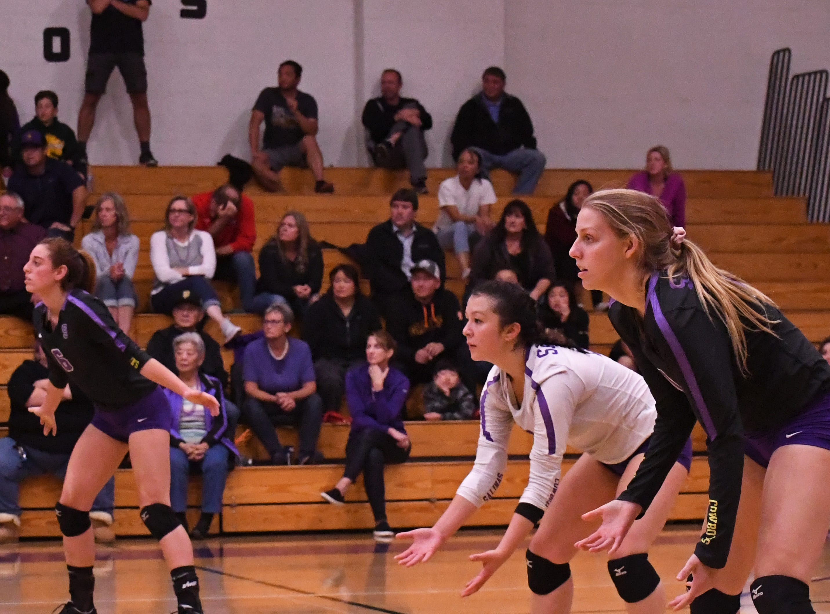 From left: outside hitter Kylee Moore (6), libero Kaila Uota (12) and outside hitter Ashleigh Souza (10) wait for a serve from Los Gatos.