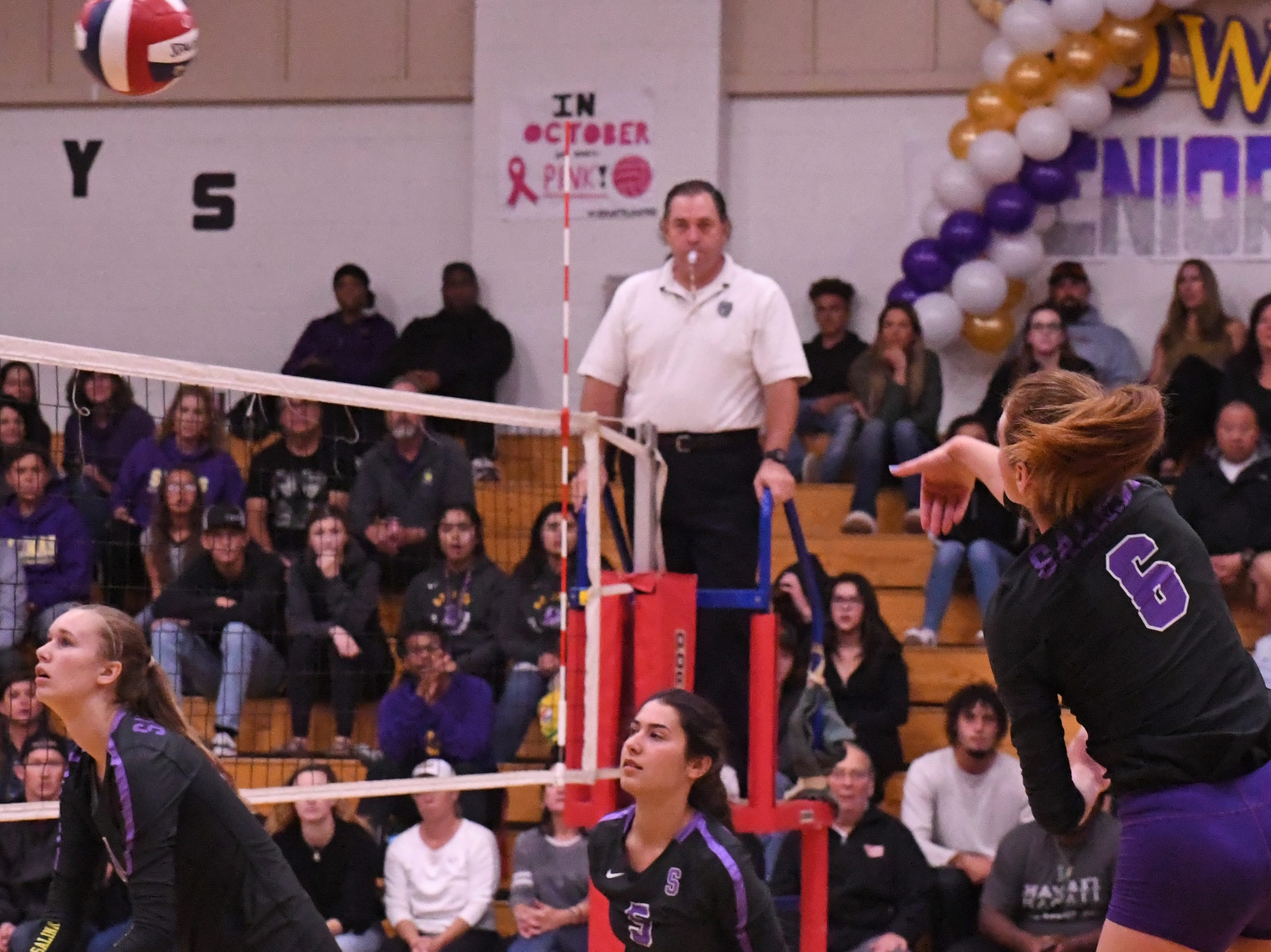 Outside hitter Kylee Moore (6) fires a shot over the net to the far corner in the third set.
