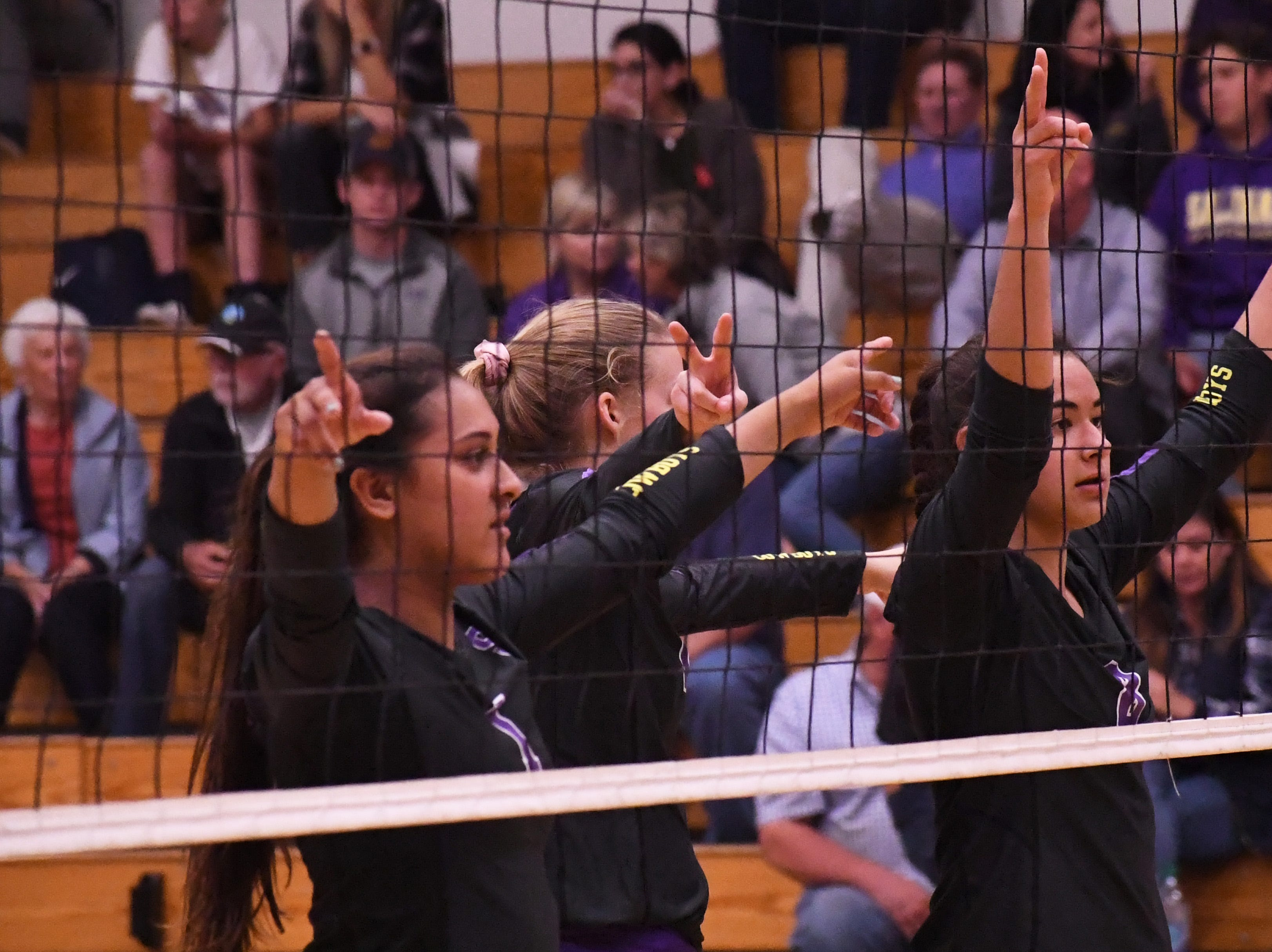 Setter Aloha Delk (1), outside hitter Ashleigh Souza (10) and middle blocker Christina Chagnon (8) wait for a serve from Kaila Uota.