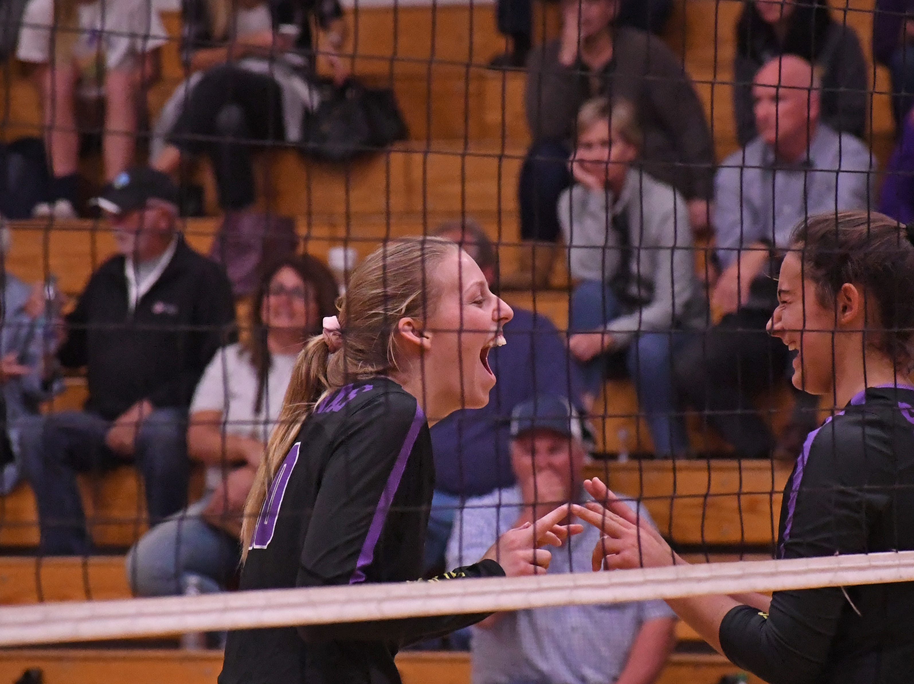 Outside hitter Ashleigh Souza (10) and middle blocker Christina Chagnon (8) share a laugh between points.