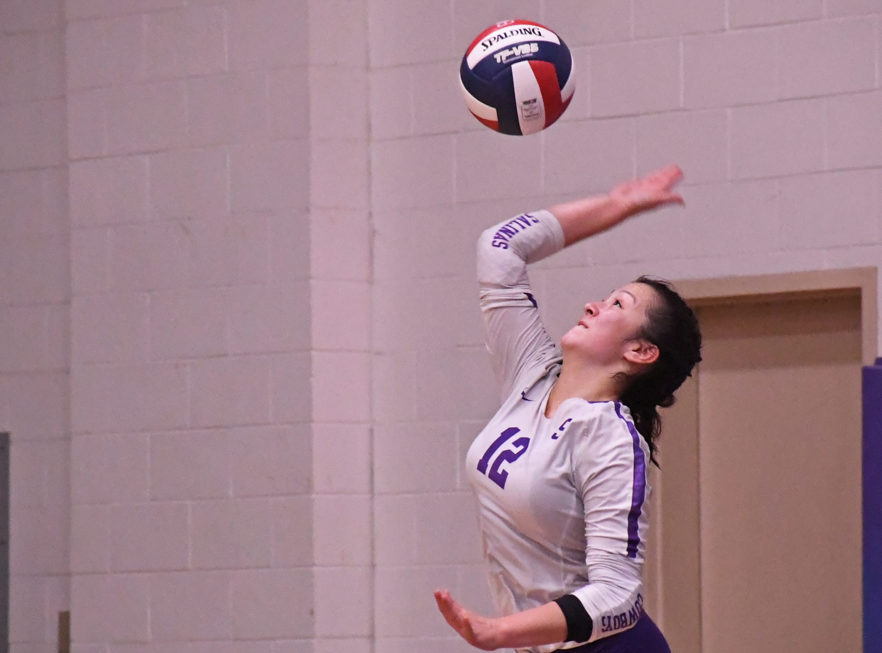 Libero Kaila Uota (12) serves the ball in the third set.
