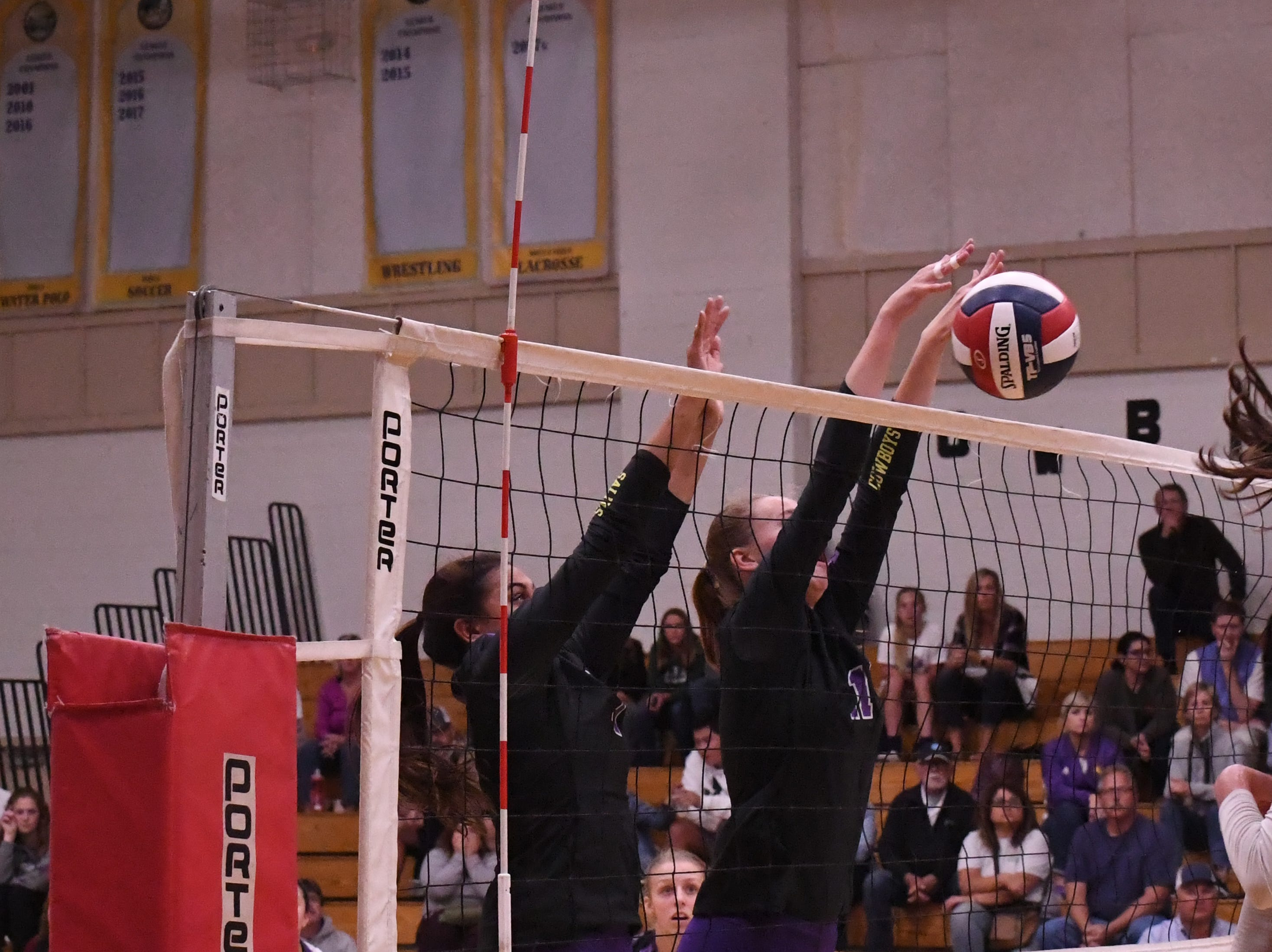 Setter Aloha Delk (1) and middle blocker Savannah Maker (11) reach for a spike by Los Gatos in the second set.