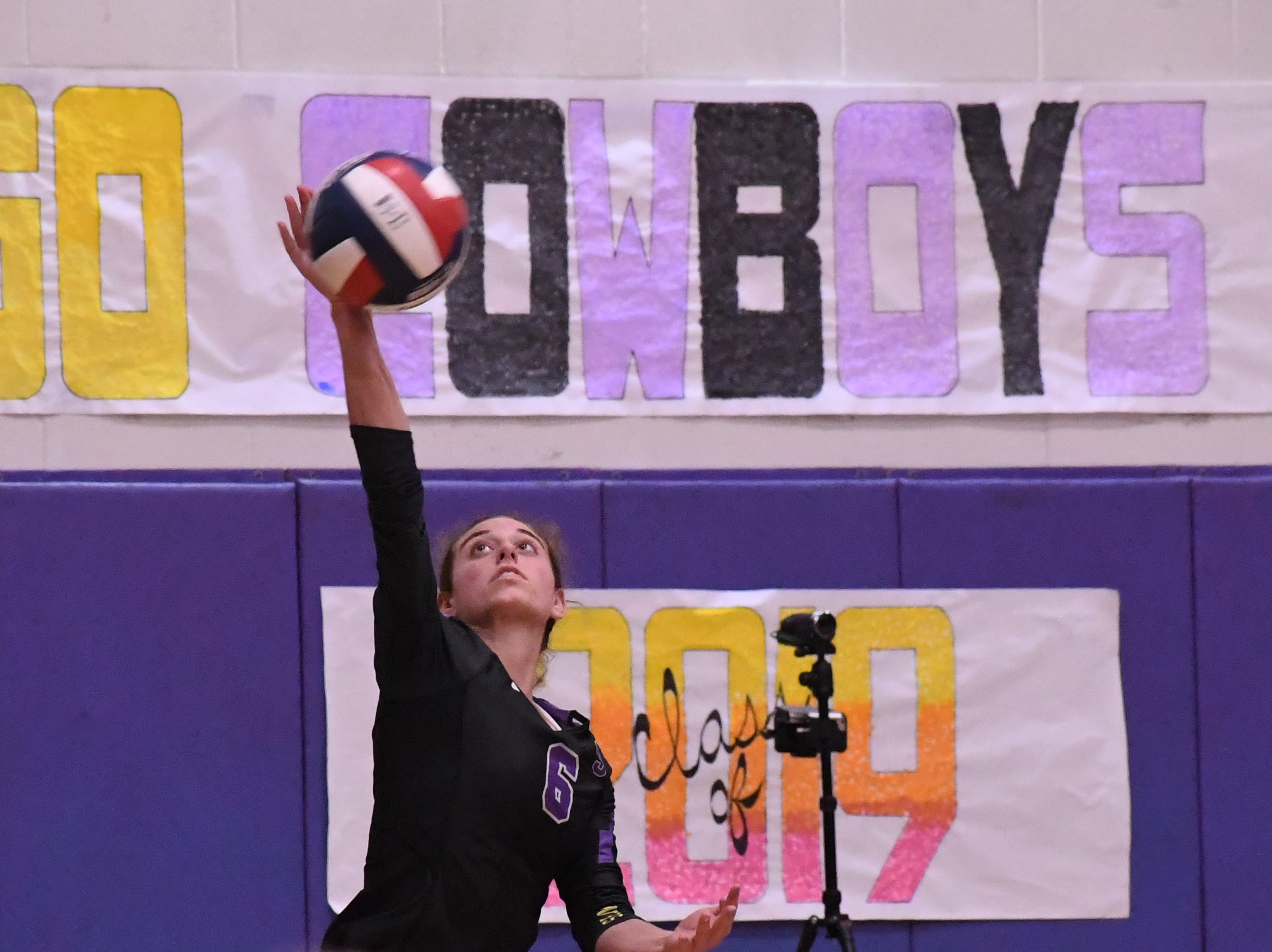 Outside hitter Kylee Moore (6) hits a serve in the second set.