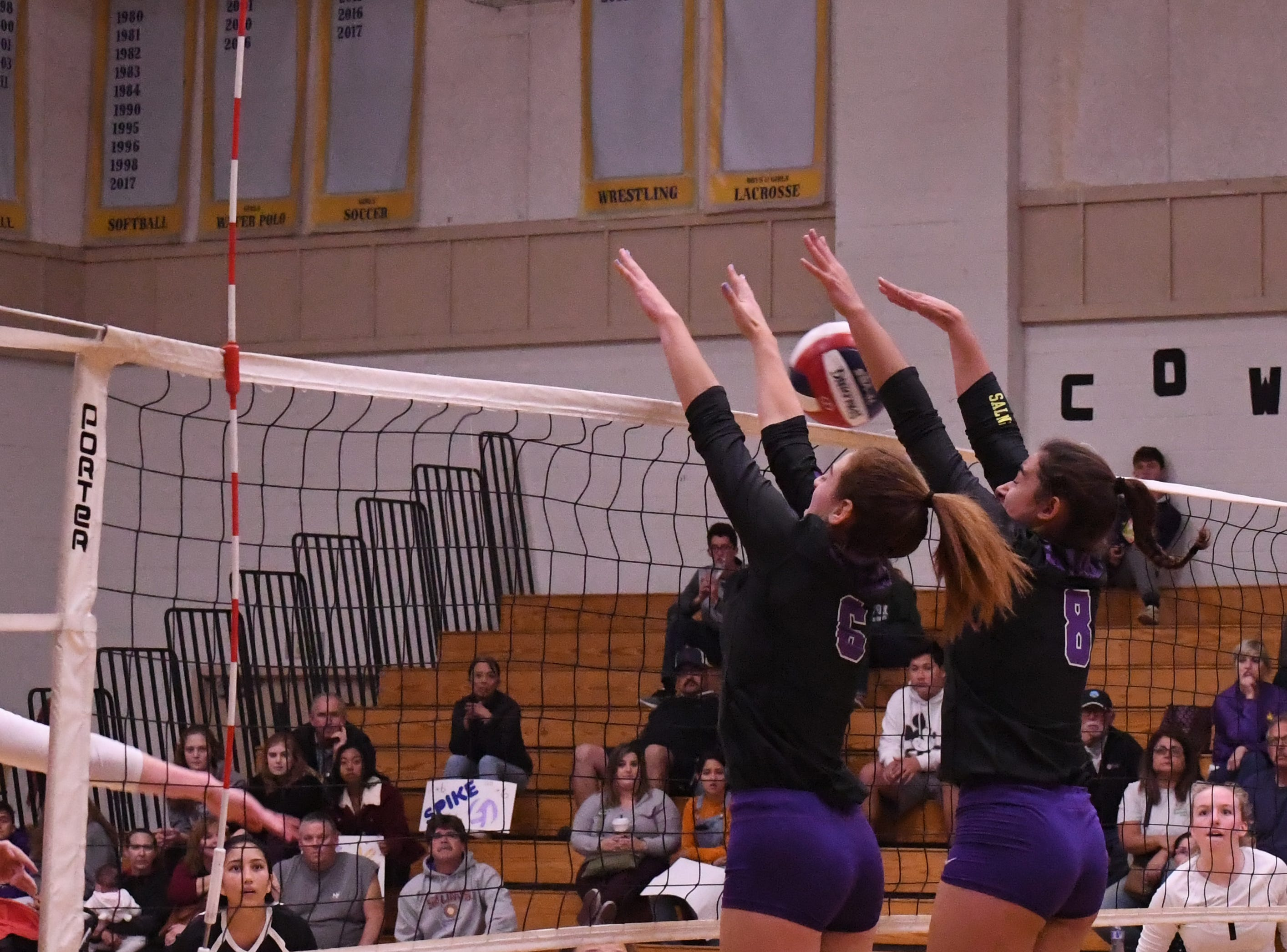 Outside hitter Kylee Moore (6) and middle blocker Christina Chagnon (8) block a spike by a Los Gatos player.