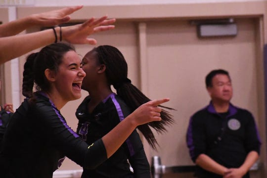 Middle blocker Christina Chagnon (8) celebrates a point in the Cowboys' win over Los Gatos Tuesday.