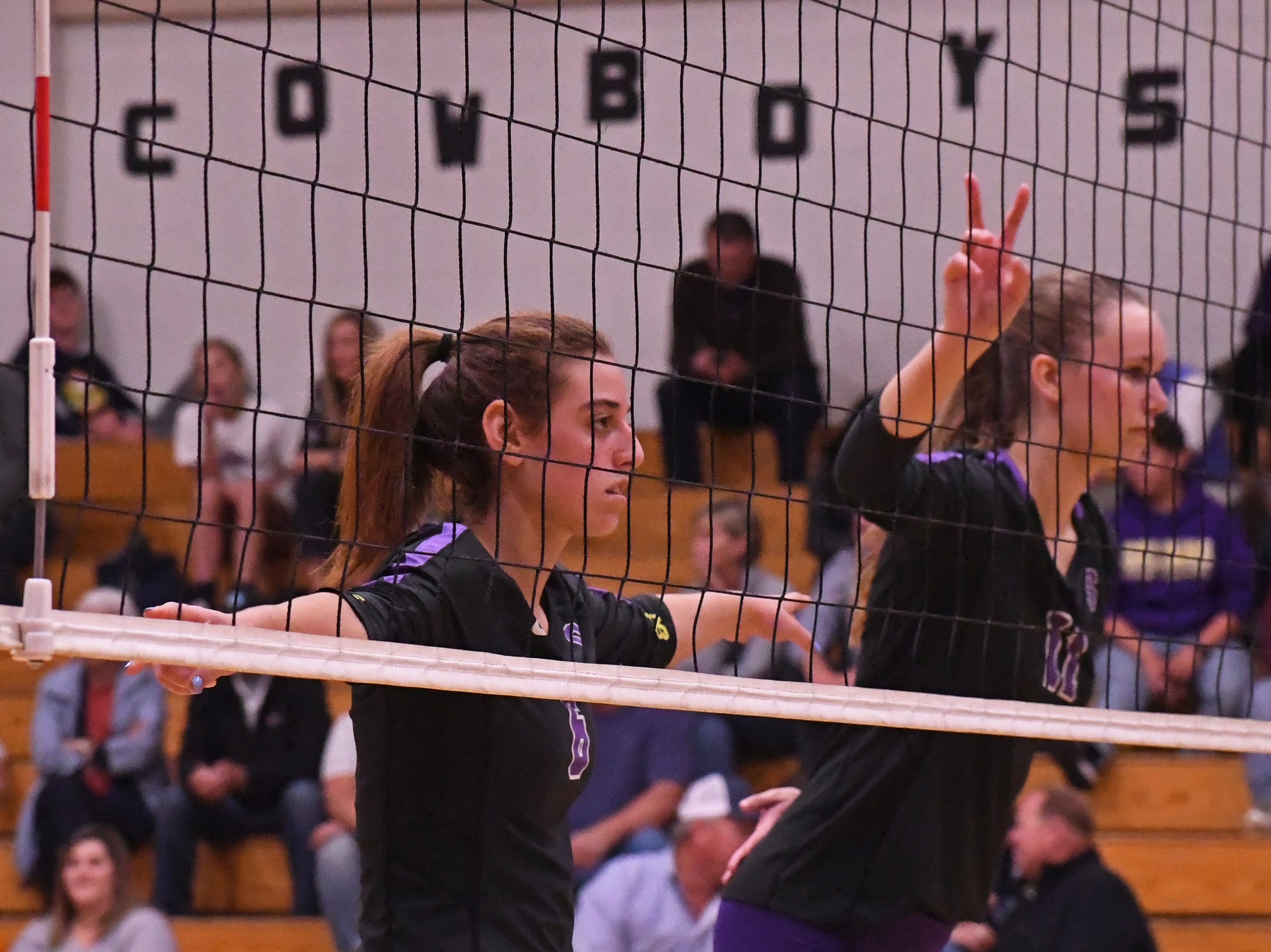 Outside hitter Kylee Moore (6) and middle blocker Savannah Maker (11) wait for Kaila Uota to serve the ball.