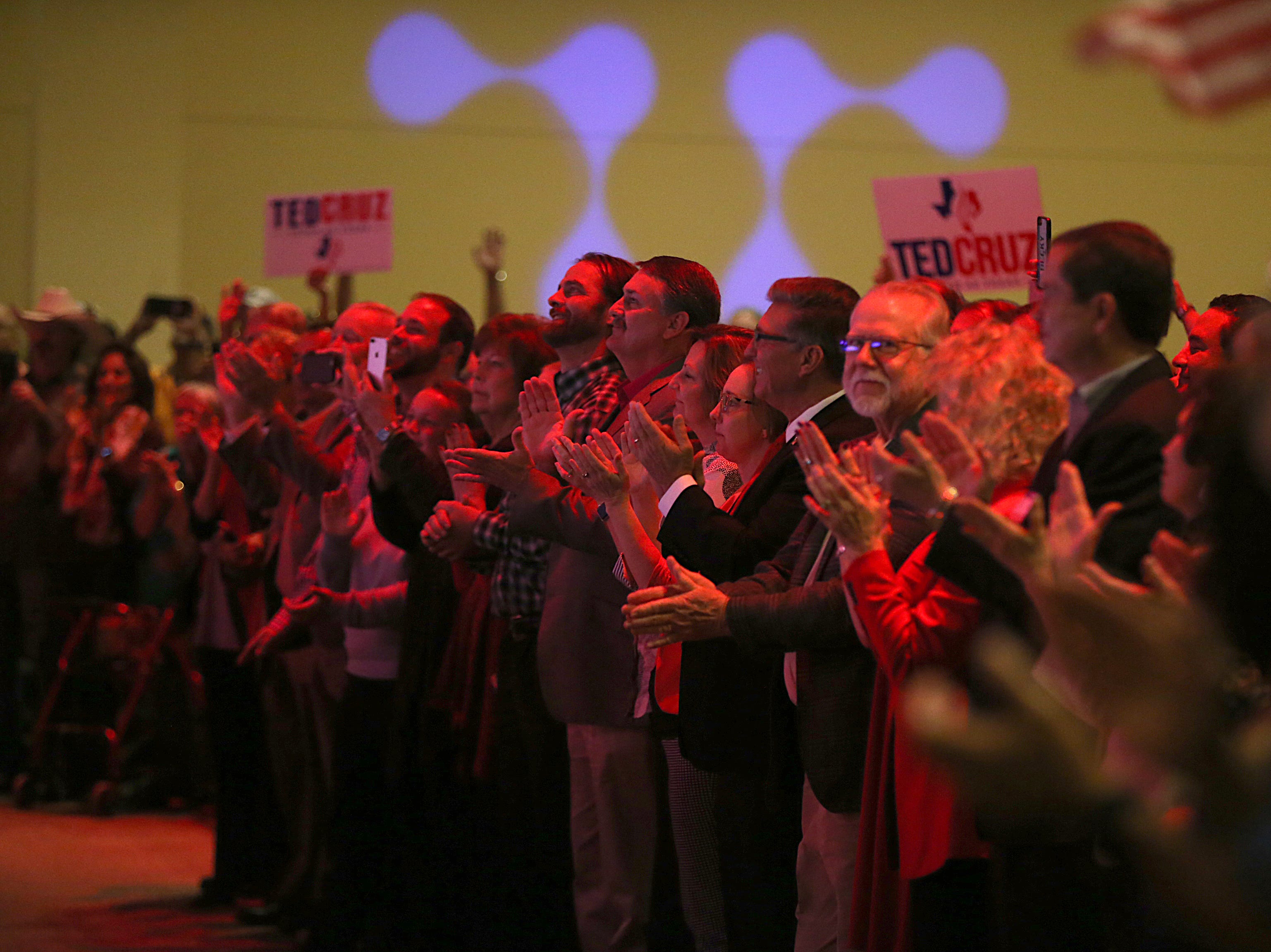 Supporters of Sen. Ted Cruz hold up signs Tuesday, Oct. 30, 2018, at a speaking event at The Life Church in San Angelo.