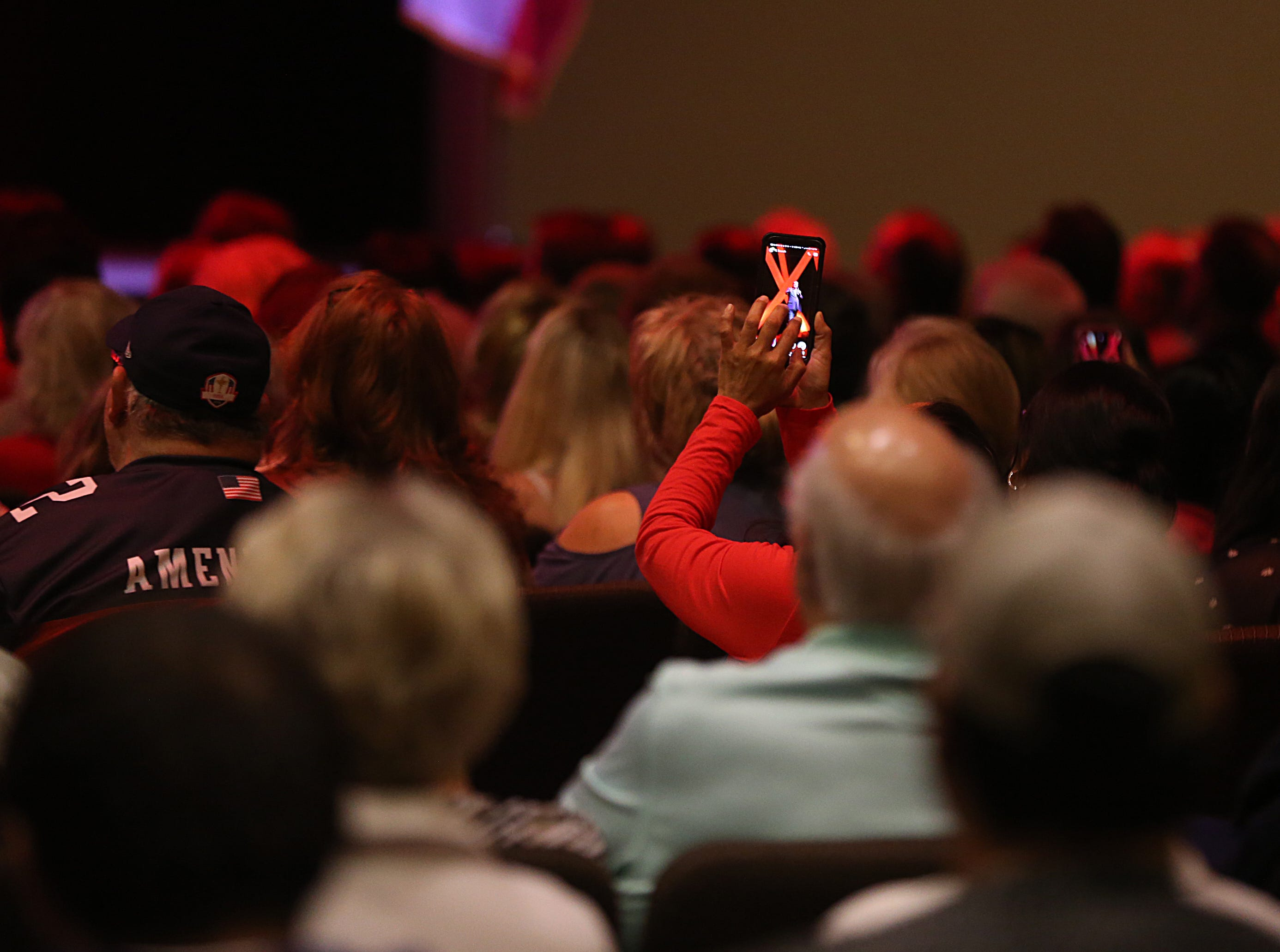 A woman takes a cell phone photo of Sen. Ted Cruz Tuesday, Oct. 30, 2018, during his campaign stop at The Life Church in San Angelo.
