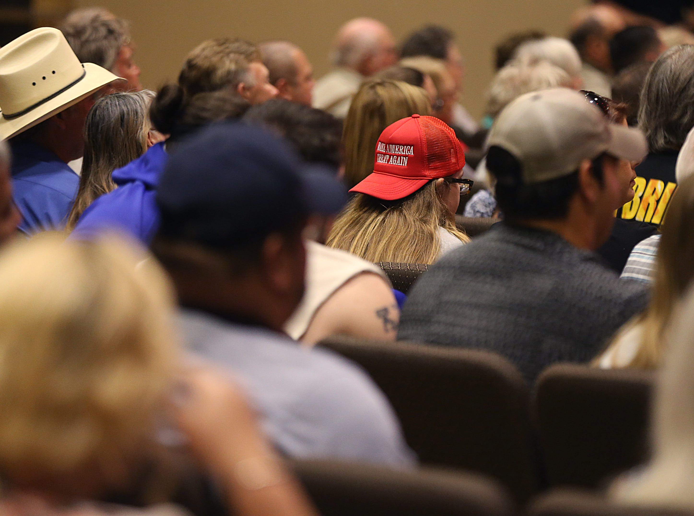 A supporter of Sen. Ted Cruz wears a Make America Great Again cap Tuesday, Oct. 30, 2018, at a speaking event at The Life Church in San Angelo.