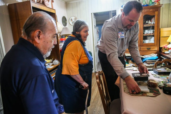 Nick George, store manager for H-E-B #2, set meals for William and Diana Rodriguez Wednesday, Oct. 31, 2018, in their home. George was delivering Feast of Sharing meals with Meals for the Elderly.
