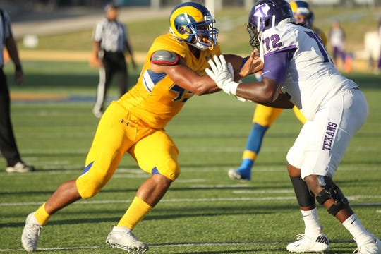 Angelo State University senior defensive end Markus Jones (left) tries to muscle his way past a Tarleton State lineman during a Lone Star Conference football game at LeGrand Stadium at 1st Community Credit Union Field on Saturday, Sept. 29, 2018.
