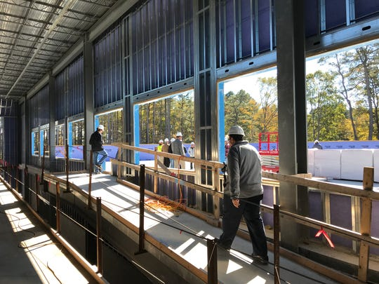 State and county officials walk the new Somerset County Public Schools technical high school with school officials in Westover on Tuesday, Oct. 30, 2018