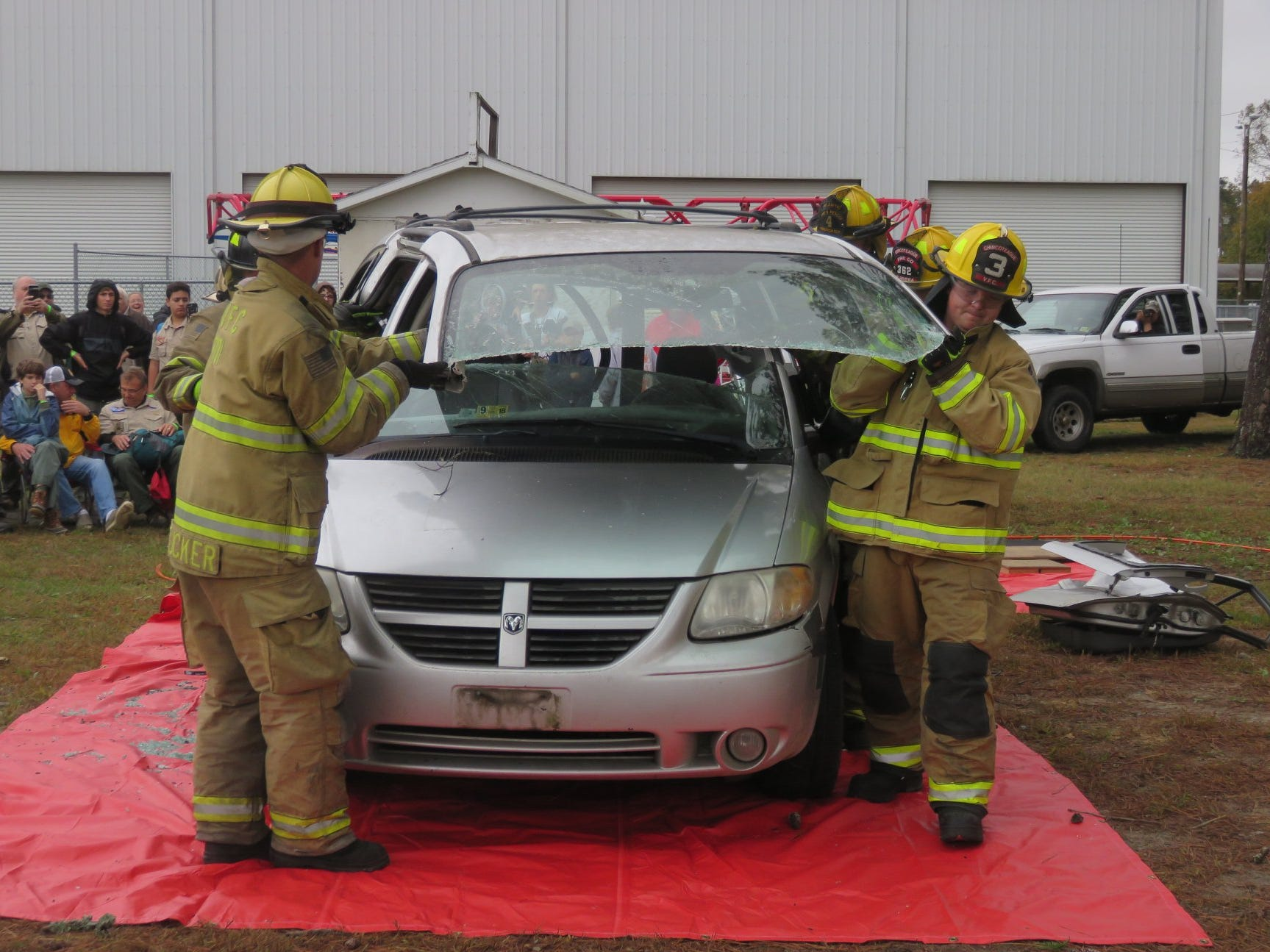 Chincoteague Volunteer Fire Company firefighters show how they respond to a vehicle crash at the Scouts Camporee.