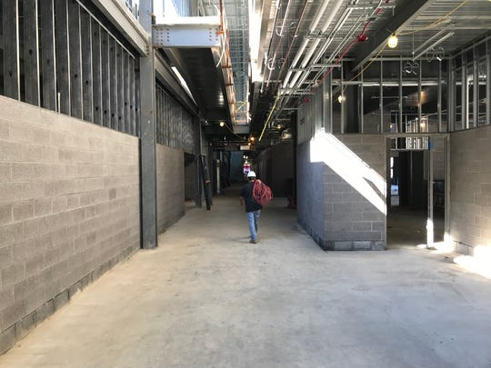 A construction worker walks through the new Somerset County Public Schools technical high school in Westover on Tuesday, Oct. 30, 2018.