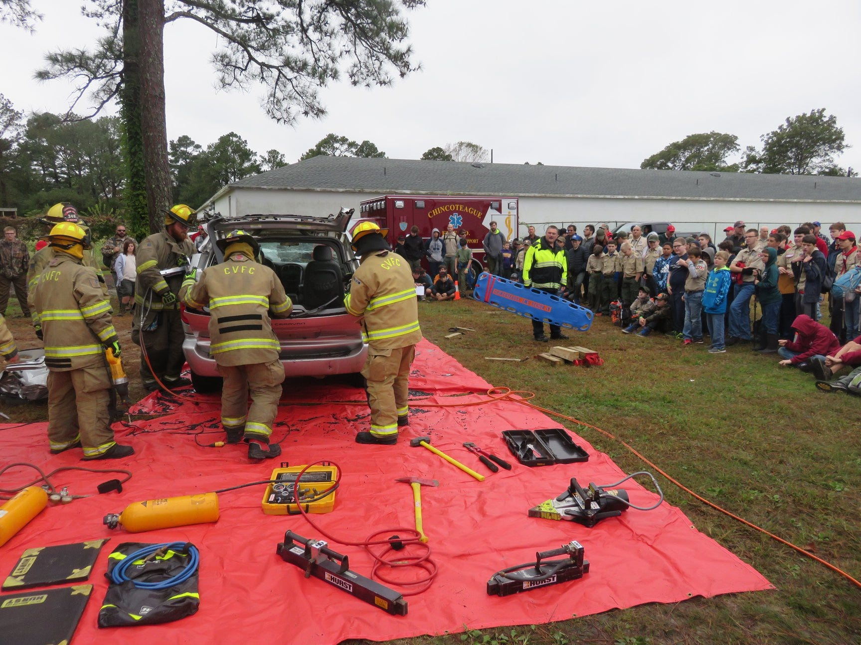 The Scouts watch as members of the Chincoteague Volunteer Fire Company demonstrate how they respond to an automobile accident during the Camporee.