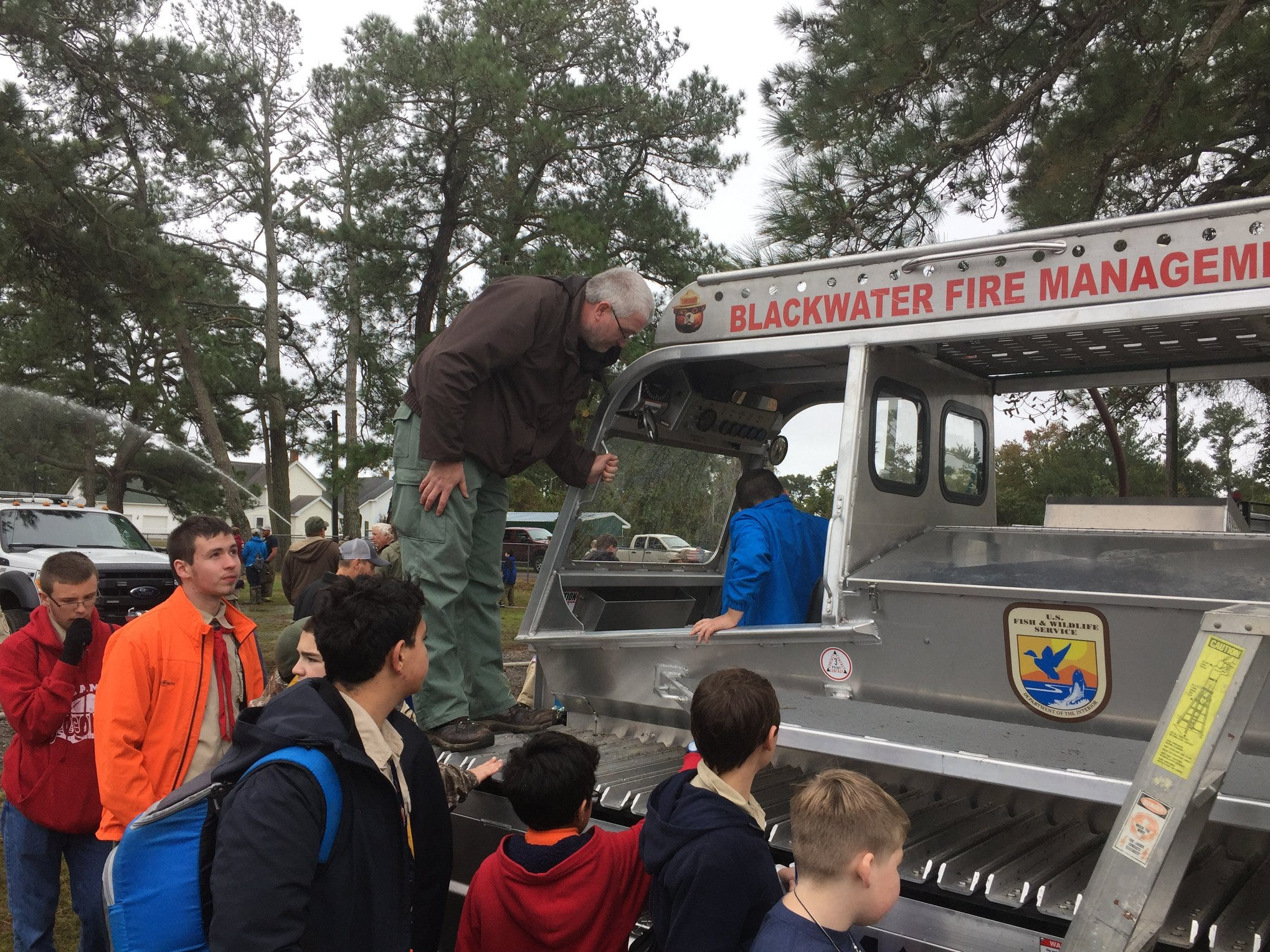 Representatives from the Blackwater National Wildlife Refuge in Maryland demonstrate their fire management vehicle at the Scouts Camporee in Chincoteague.