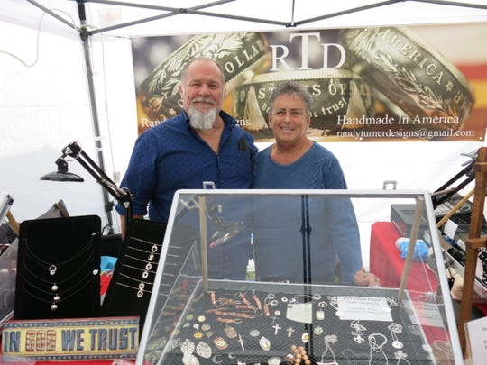 Vendors show off jewelry which was popular with browsers at Shanker Creek.