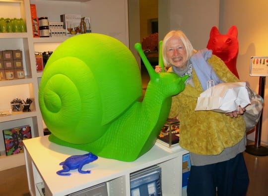Maggie stands by a snail at the 21 C Museum Hotel Gift Shop.