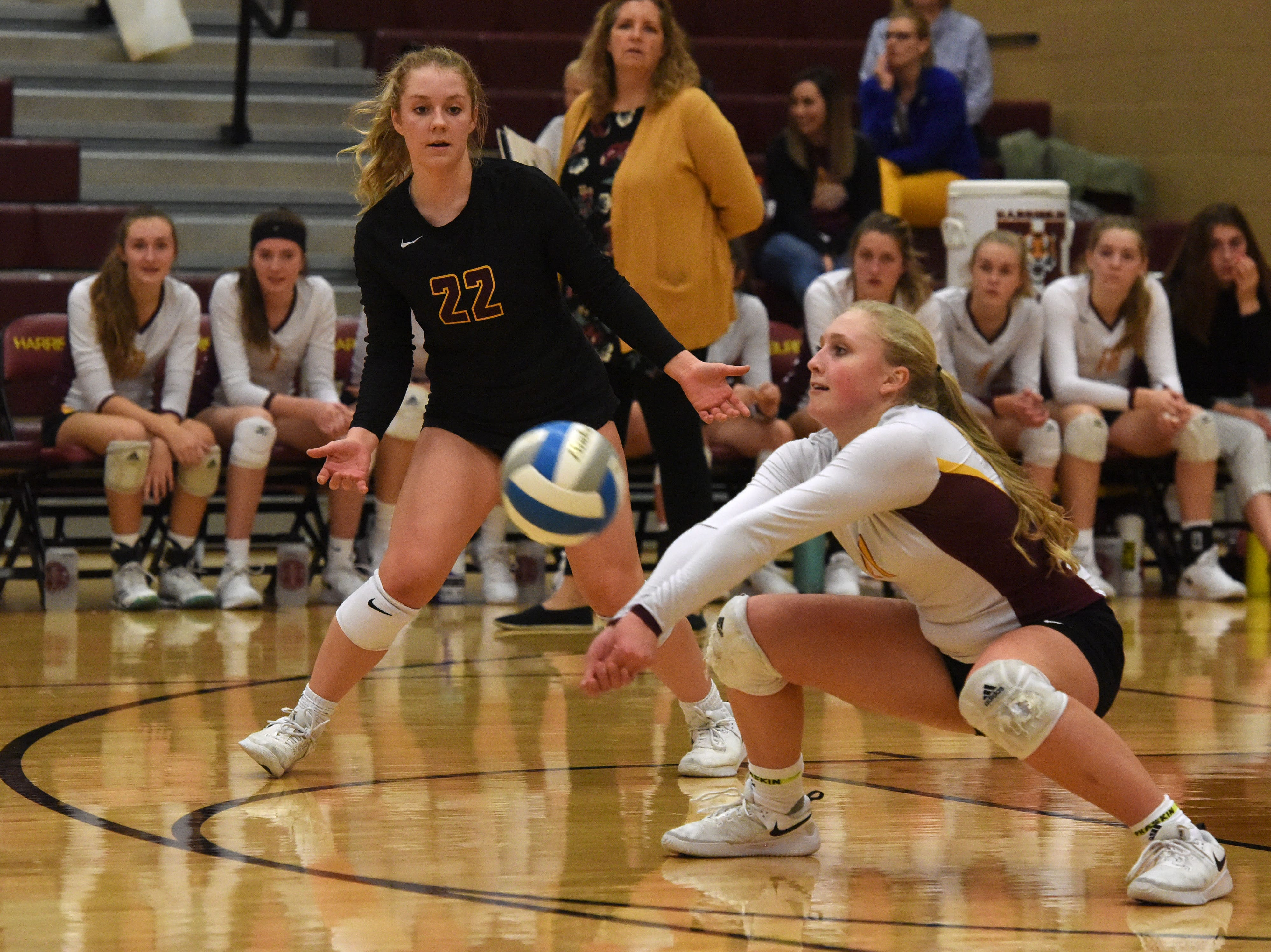 Harrisburg's Abby Meister (11) bumps the ball during a match against Brookings Tuesday, Oct. 30, 2018 in Harrisburg, S.D.