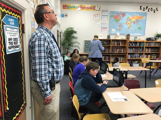 Assistant principal Mike Moore checks in on a sixth grade class Oct. 24 at Whittier Middle School.