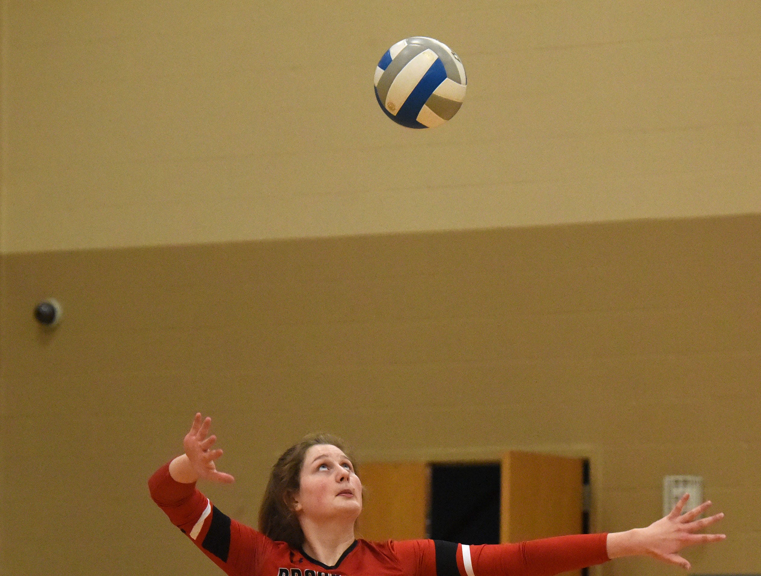 Brookings' Michaela Jewett (13) serves the ball during a match against Harrisburg Tuesday, Oct. 30, 2018 in Harrisburg, S.D.