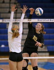 Mitchell's Mackenzie Miller (right) graduates as the Kernels' all-time leader in kills (1,189) and ranks second all-time in digs (1,095).