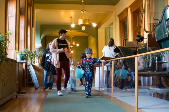 Jack Nelson, 5, trick or treats Wednesday, Oct. 31, 2018 at the Old Courthouse Museum in Sioux Falls, S.D.