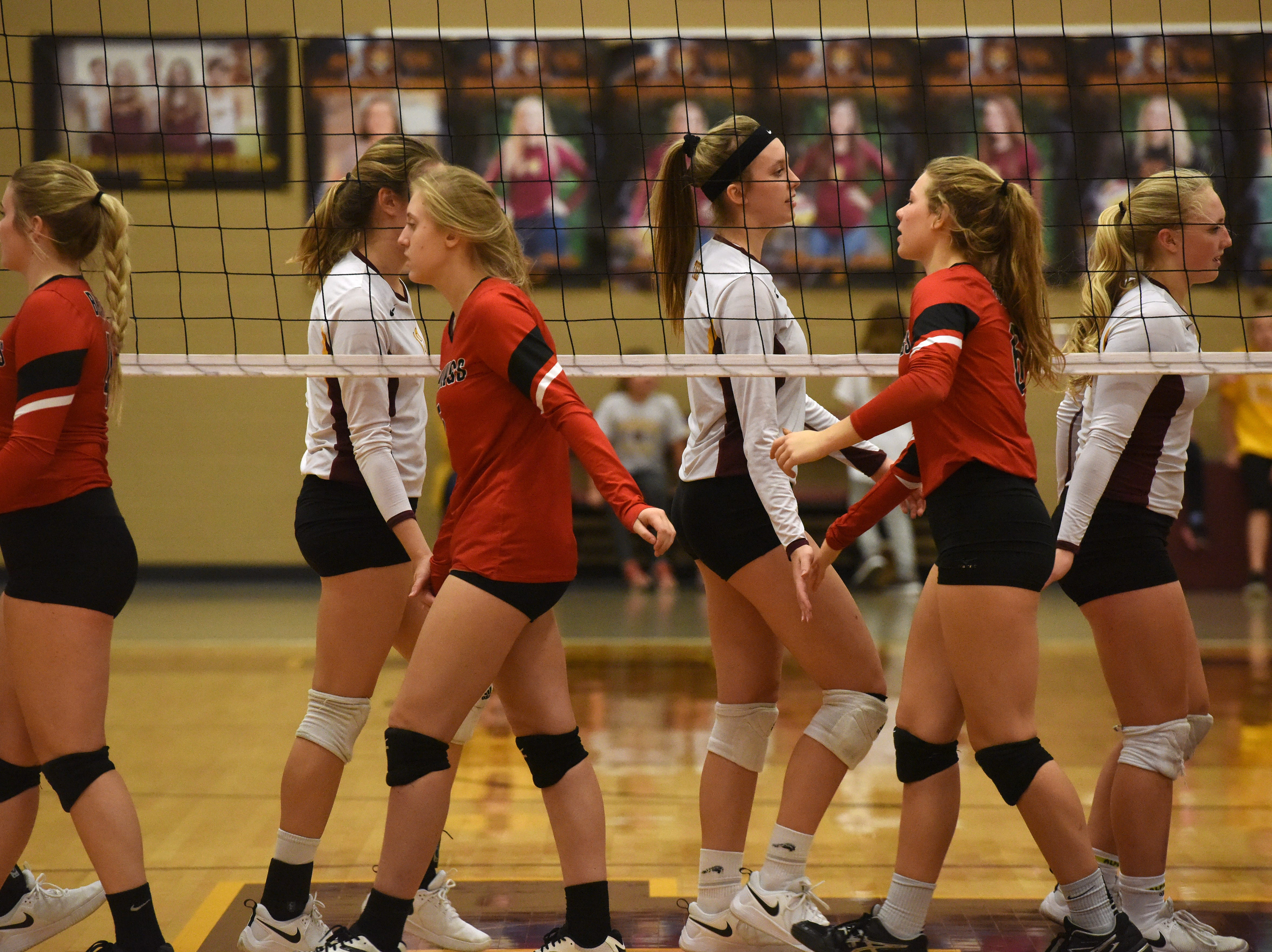 Harrisburg and Brookings' players give each other high-fives before a match Tuesday, Oct. 30, 2018 in Harrisburg, S.D.