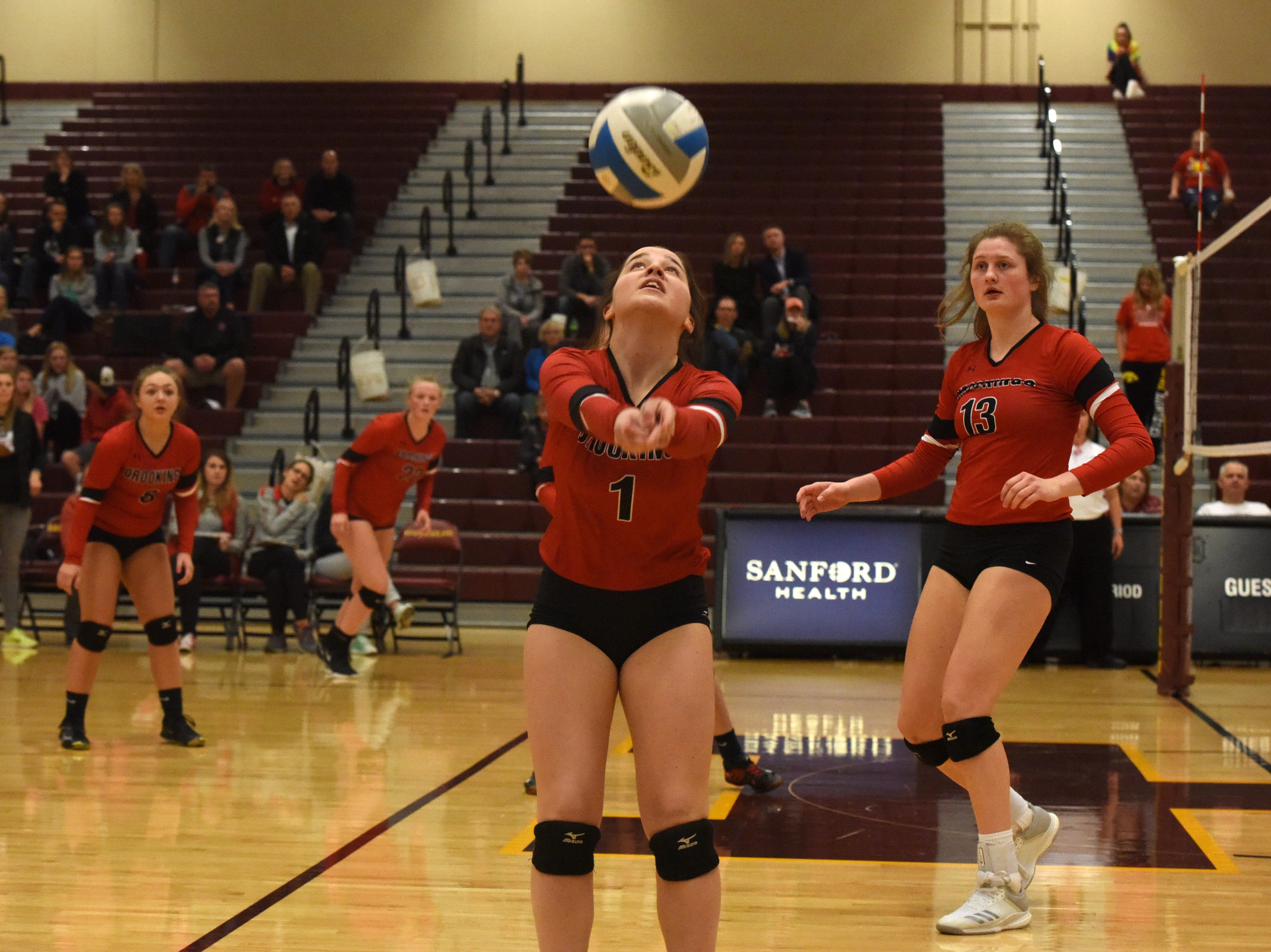 Brookings' Molly Steffensen (1) bumps the ball during a match against Harrisburg, Tuesday, Oct. 30, 2018 in Harrisburg, S.D.