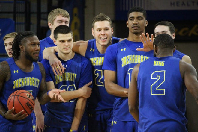 Mike Daum (center) will be expected to lead the SDSU men back to a fourth straight NCAA tournament in 2018-19