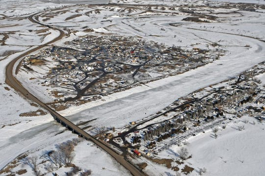 This aerial photograph shows North Dakota Highway 1806, at left, where it crosses Cannonball River and protest camps on both sides of the river during the Dakota Access Pipeline protest in February 2017. Some South Dakota officials are concerned about a state law that requires counties to pay a significant amount for protest activities before the state steps in with financial help. It cost more than $40 million to handle the protest in North Dakota.