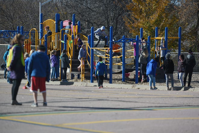 Eugene Field recess Wednesday, Oct. 31, in Sioux Falls. The school does not have a grassy area for the students to play. The administration had to get creative to keep the students occupied during recess.