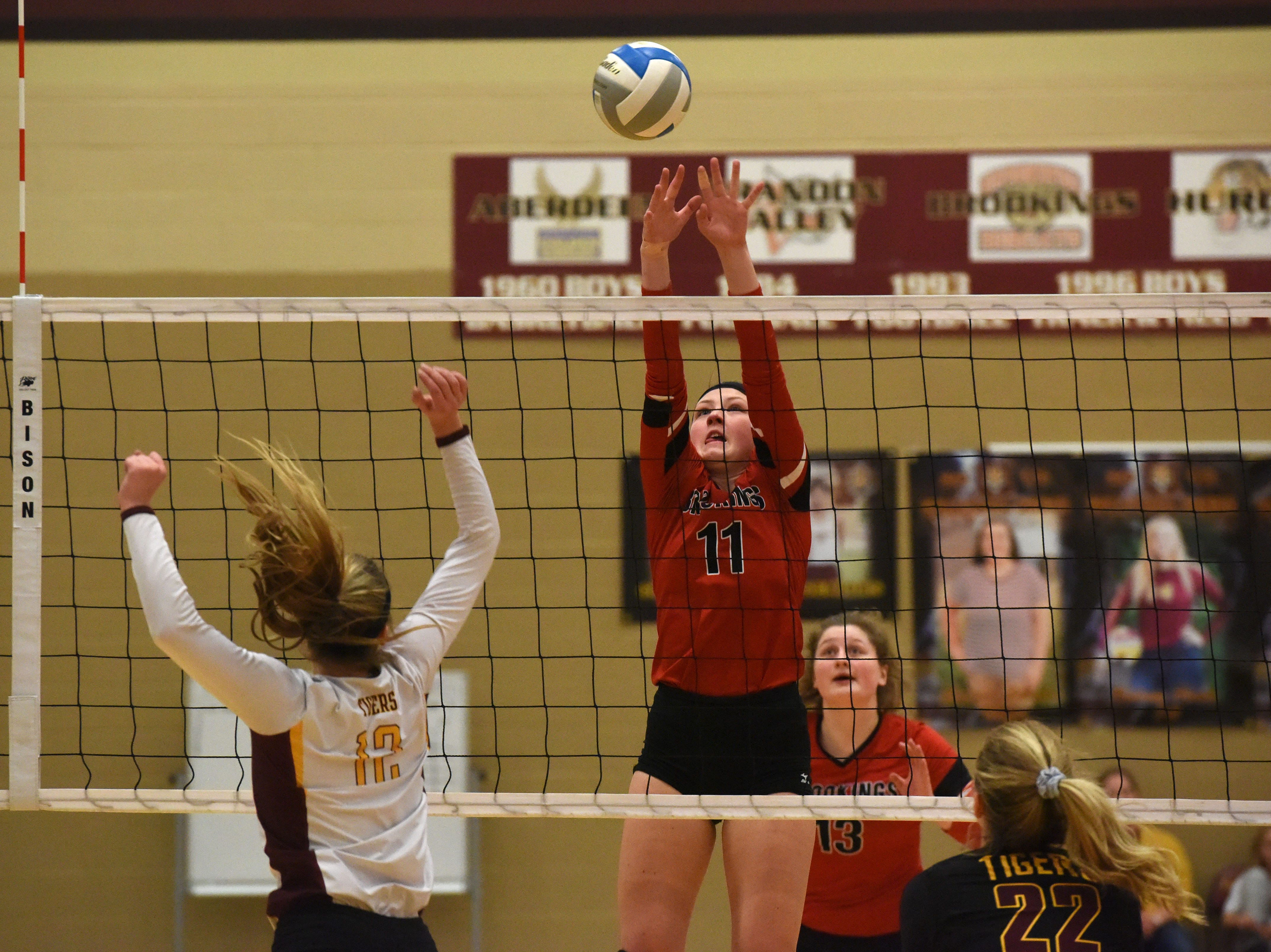 Brookings' Clarissa Miller (11) goes to block the ball during a match against Harrisburg Tuesday, Oct. 30, 2018 in Harrisburg, S.D.