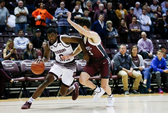 Missouri State senior Josh Webster drives the ball to the basket around Evangel senior Luke Call as the Bears take on the Crusaders at JQH Arena on Tuesday, Oct. 30, 2018.