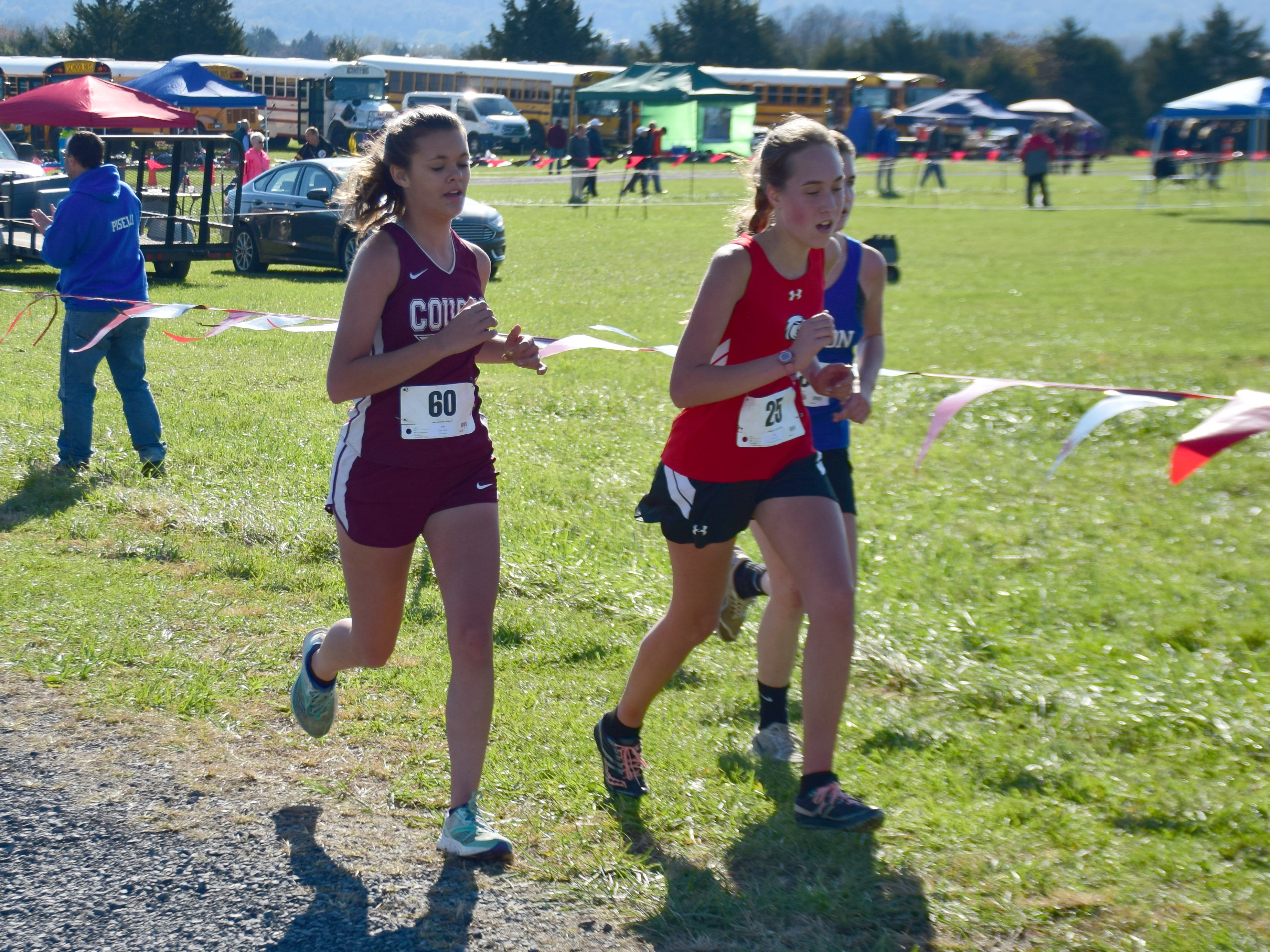 Stuarts Draft's Amelia Grenz, left, competes in the girls race at the VHSL Class 2, Region B Cross Country Championships on Tuesday, Oct. 30, 2018, at New Market Battlefield Park in New Market, Va.