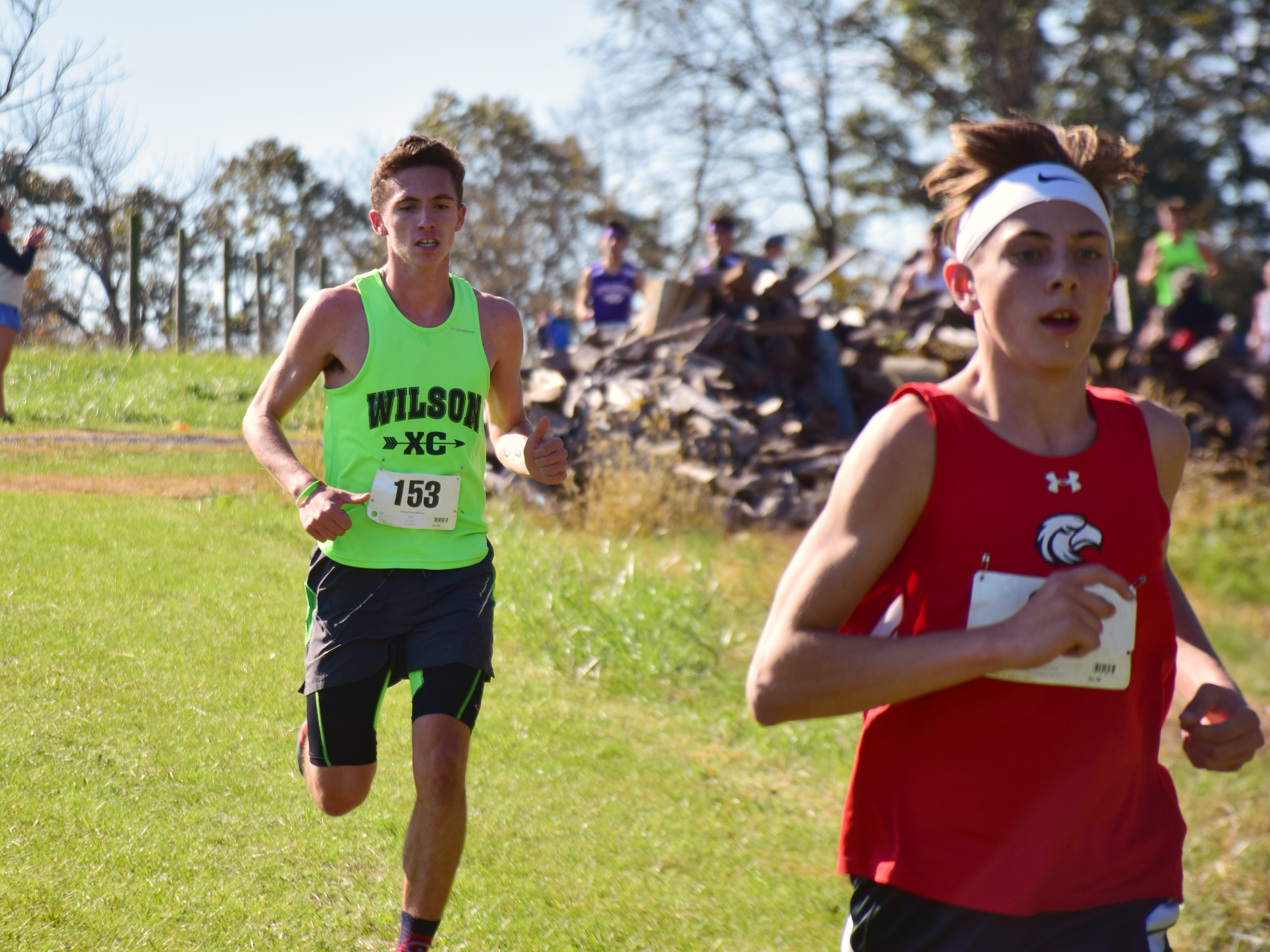 Wilson Memorial's Vincent Leo, left, keeps pace with East Rockingham's George Austin III during the boys race at the VHSL Class 2, Region B Cross Country Championships on Tuesday, Oct. 30, 2018, at New Market Battlefield Park in New Market, Va.