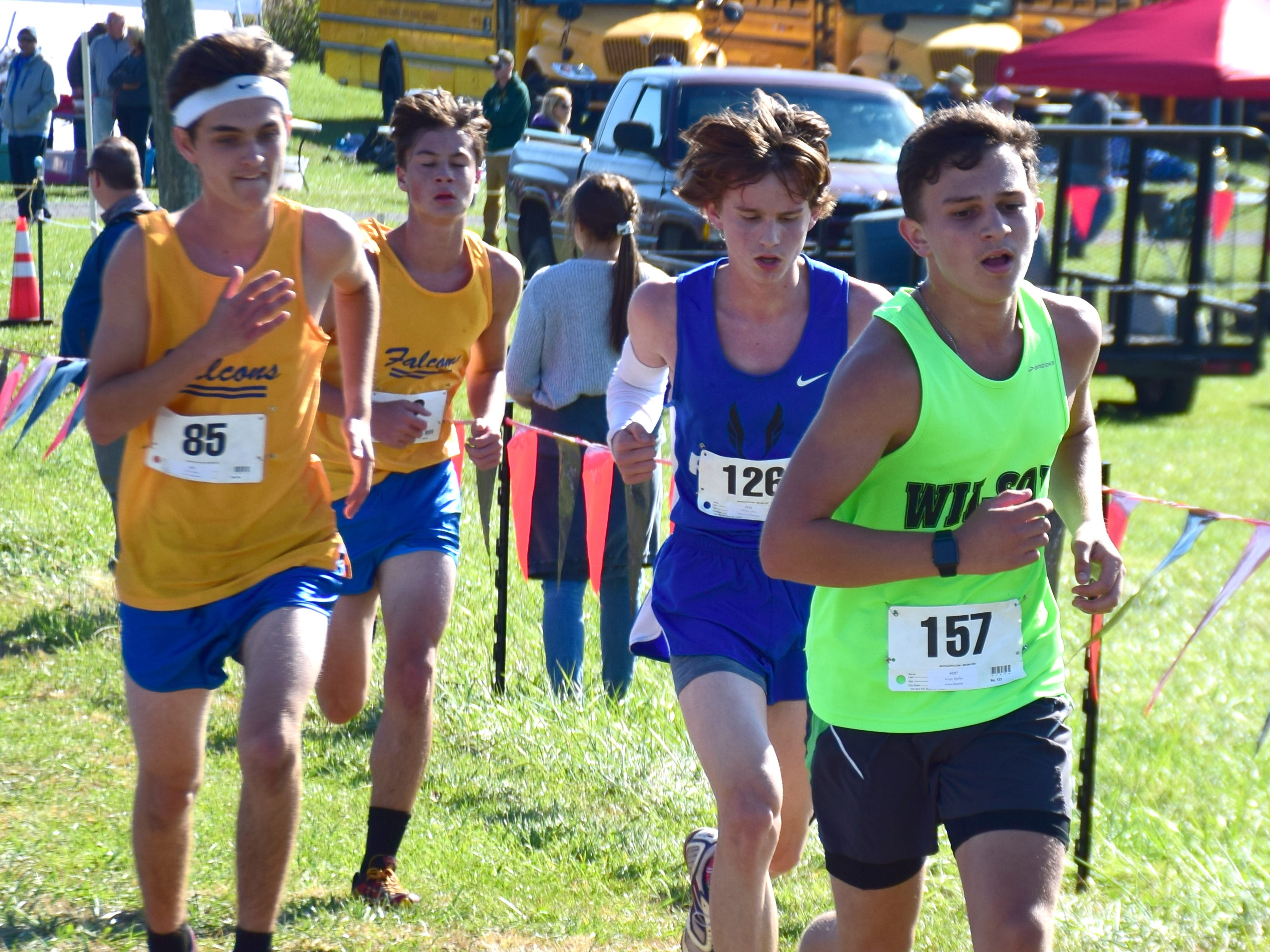 From right, Wilson Memorial's Bradley Wright and Robert E. Lee's Calvin Siemers compete in the boys race at the VHSL Class 2, Region B Cross Country Championships on Tuesday, Oct. 30, 2018, at New Market Battlefield Park in New Market, Va.
