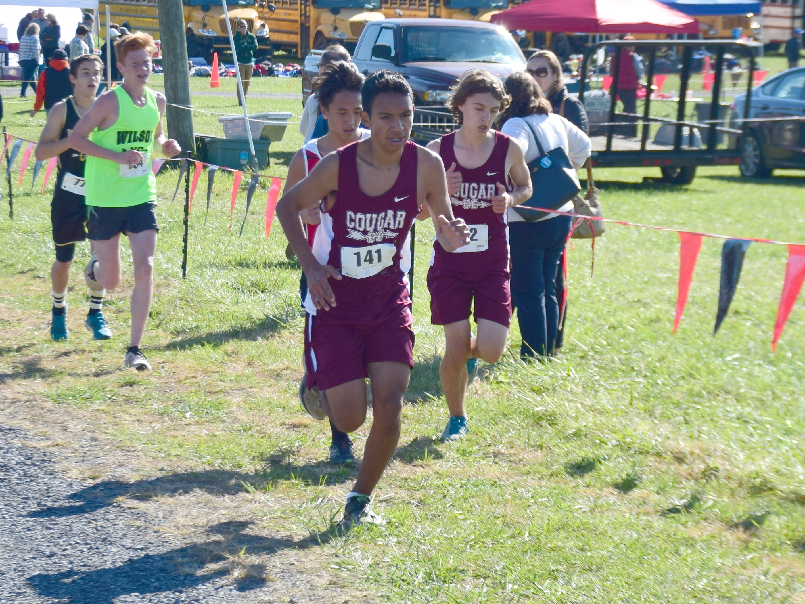 Stuarts Draft's Lukas Barrigan, center, and Alexander Callo, right, compete in the boys race at the VHSL Class 2, Region B Cross Country Championships on Tuesday, Oct. 30, 2018, at New Market Battlefield Park in New Market, Va.