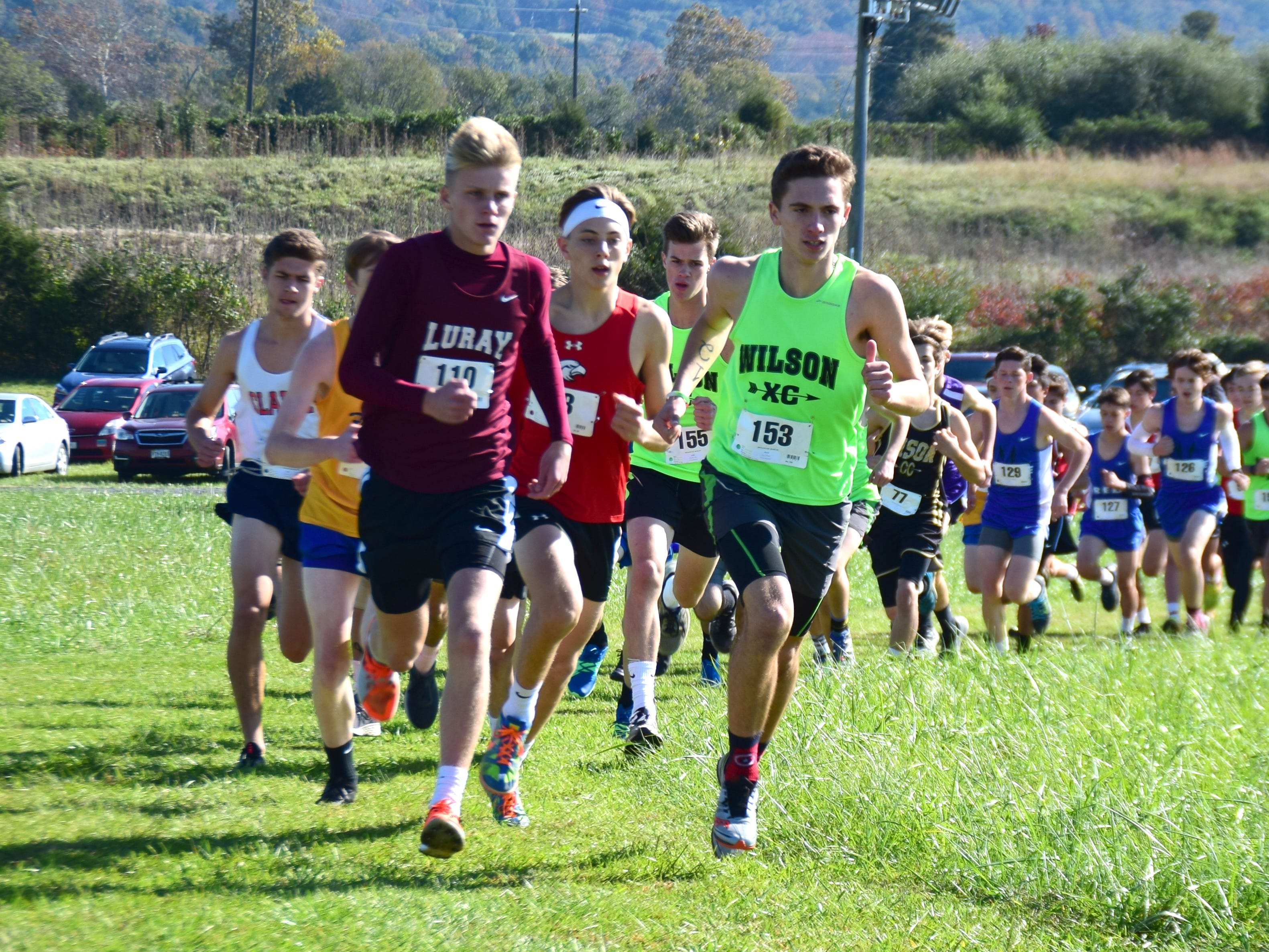 Wilson Memorial's Vincent Leo leads the main pack in the early stages of the boys race at the VHSL Class 2, Region B Cross Country Championships on Tuesday, Oct. 30, 2018, at New Market Battlefield Park in New Market, Va.