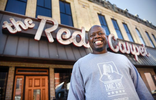 Local comedian Adrian Washington smiles Wednesday, Oct. 31, outside the Red Carpet Nightclub in St. Cloud.