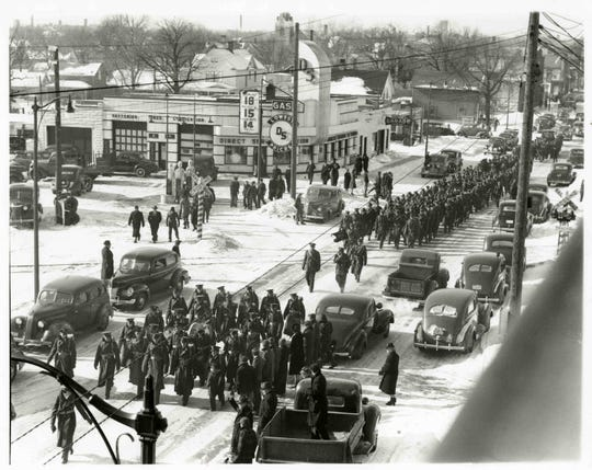 The 217th Coast Artillery marches to the train station for a trip to Camp Haan, located in California, on Feb. 20, 1941.
